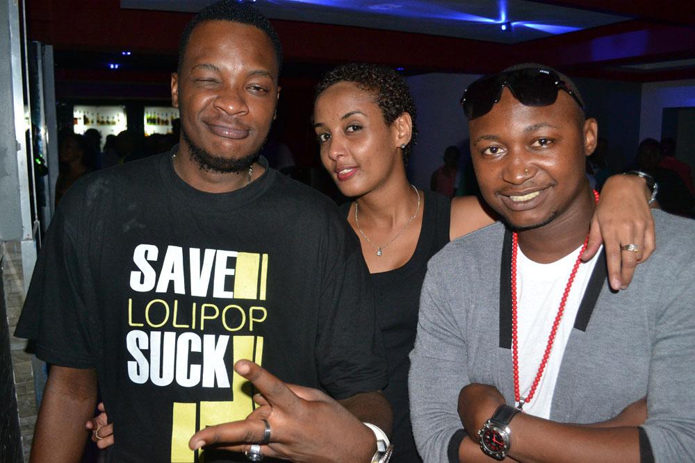 Watangazaji wa Clouds FM Adam Mchomvu na Dj Fetty wakiwa na Chidi Benz Ambassador Lounge