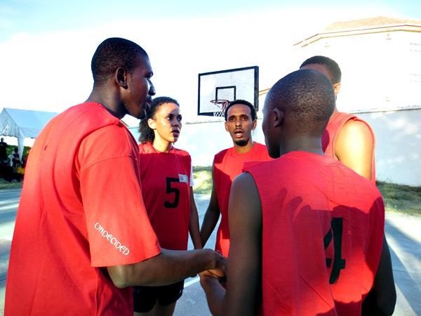 Wachezaji wa Osterbay Basketball wakishauriana jambo hapo jana katika Basketball tournament